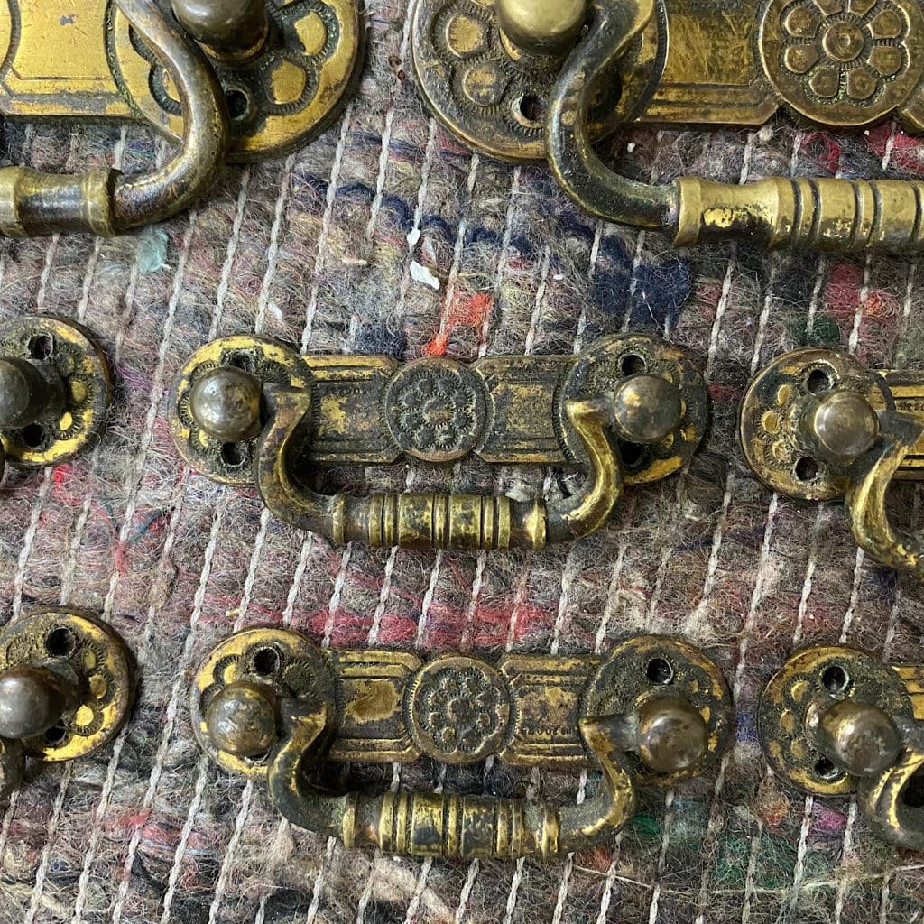 Close up of dirty brass handles