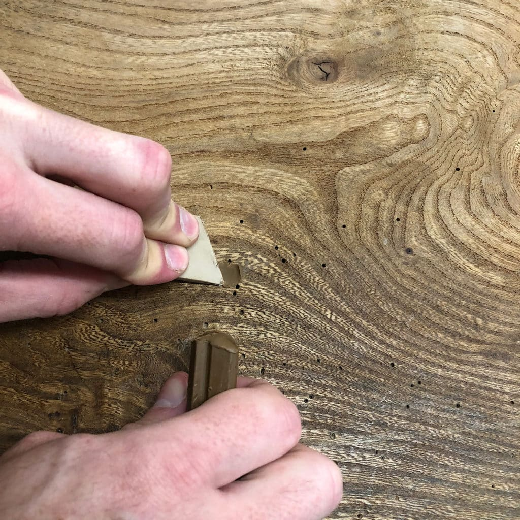 Wax fill the woodworm holes