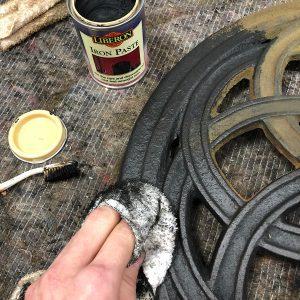 Apply Liberon Iron Paste with a cloth