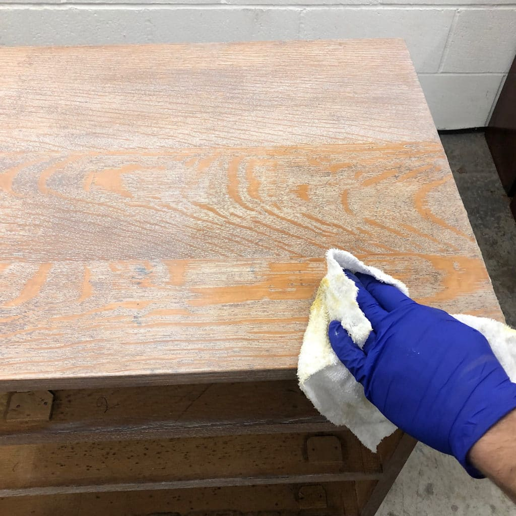 Apply clear Bees Wax to the Limed wood